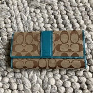 Coach trifold wallet in signature fabric